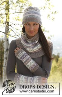 """Set consist of: Knitted DROPS wrist warmers, hat and neck warmer with pattern borders in """"Karisma"""". ~ DROPS Design"""