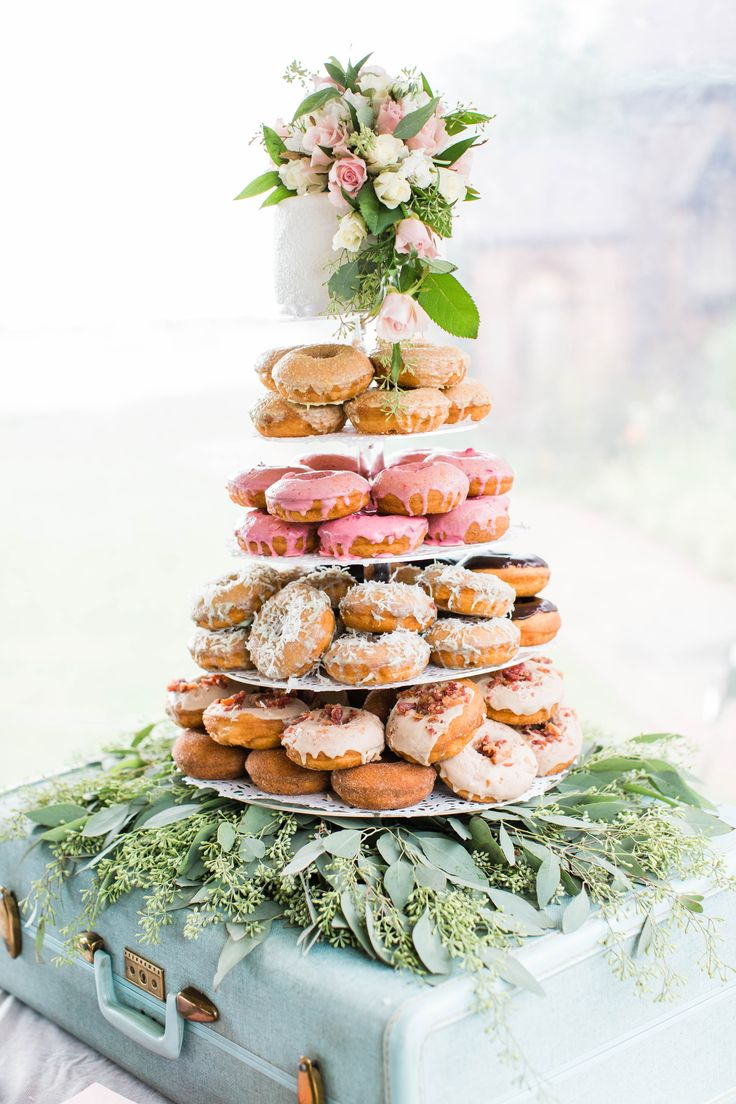 Our amazing couple opted to have a petite wedding cake AND their favorite donuts too! This stacked donut wedding tier was the pretty and the guests loved all the donut choices they could sample!