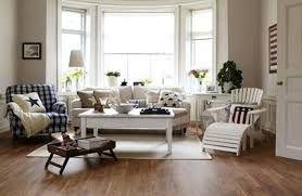 white sofa with blue plaid chair