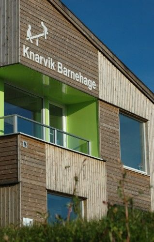 Knarvik Kindergarden designed by M3 Architecture. Logo and words displayed on the facade welcomes visitors and creates a unique identity.