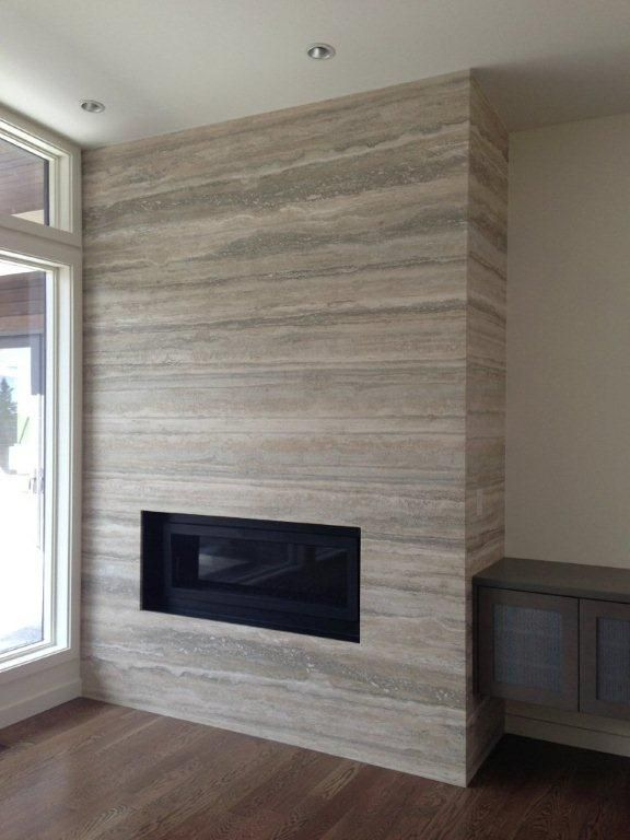 Silver Travertine natural stone slab fireplace surround. Visit globalgranite.com for your natural stone needs.