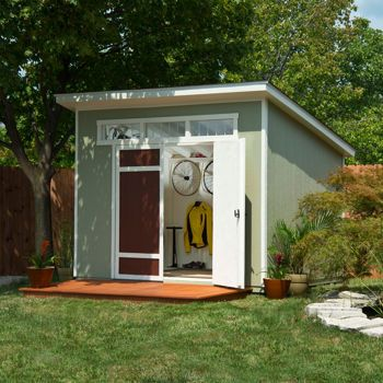 Love this little MCM backyard shed!