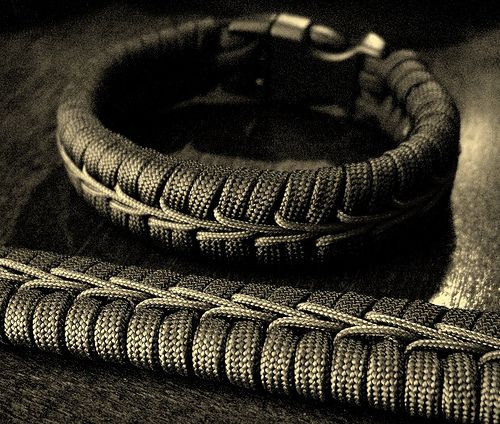 Center stitched paracord bracelets...since I'm repinning a link to an image, i THINK the center cord is just one piece wrapped down around two bars on alternating sides... looks cool!