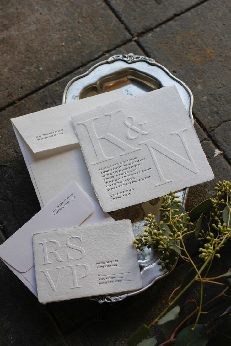 roma invitation suite roma is soft-spoken with a bold presentation. our four-deckle cotton papers are perfectly suited to achieve the chiseled serifs in this embossed design. SHOWN IN: black ink + blind emboss on white handmade paper with full deckle, handmade paper envelope