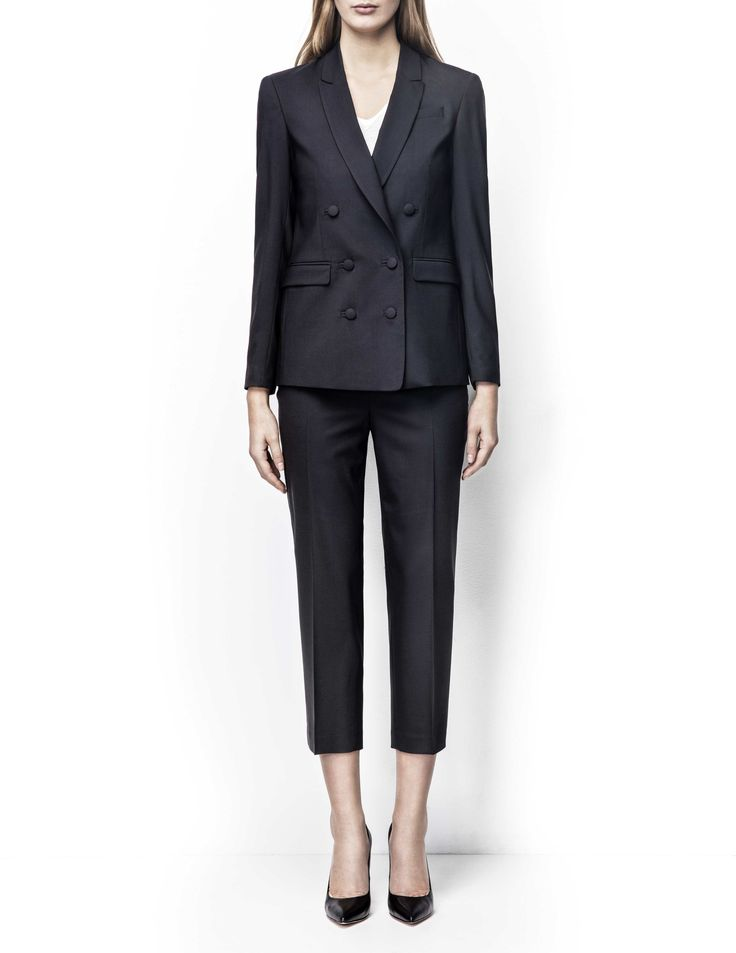 Adah blazer - Women's black blazer in wool-stretch. Fully lined with double-breasted fastening with fabric-covered buttons. Features two paspoil pockets. Semi-slim fit. Premium quality fabric from Italian weaver Marzotto For a complete suit look wear it with Kalila trousers
