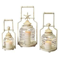Decorate your beach casa with these beautiful Beach Nautical Shell Lanterns from Paradise Water Fountains. #lantern #beach #shell #outdoor #waterfountain This charming set of three shell nested lanterns are made in the traditional style. The distressed white finish frames have a darling shell accent above the chimney.