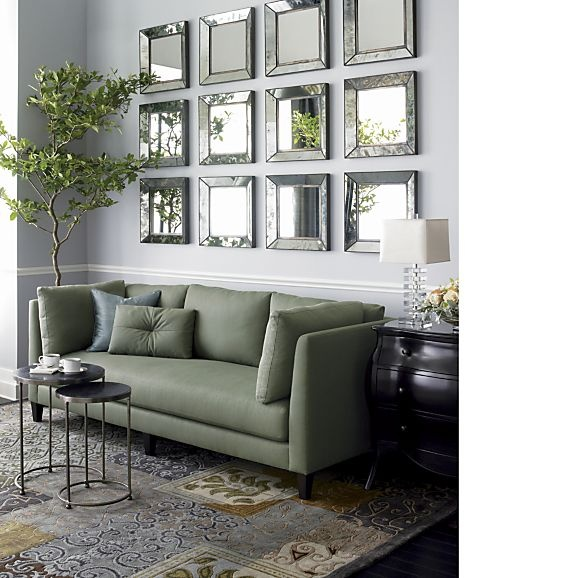 A Light Gray Wall Paint Colour Is The Perfect Background To Soft Green Couch And