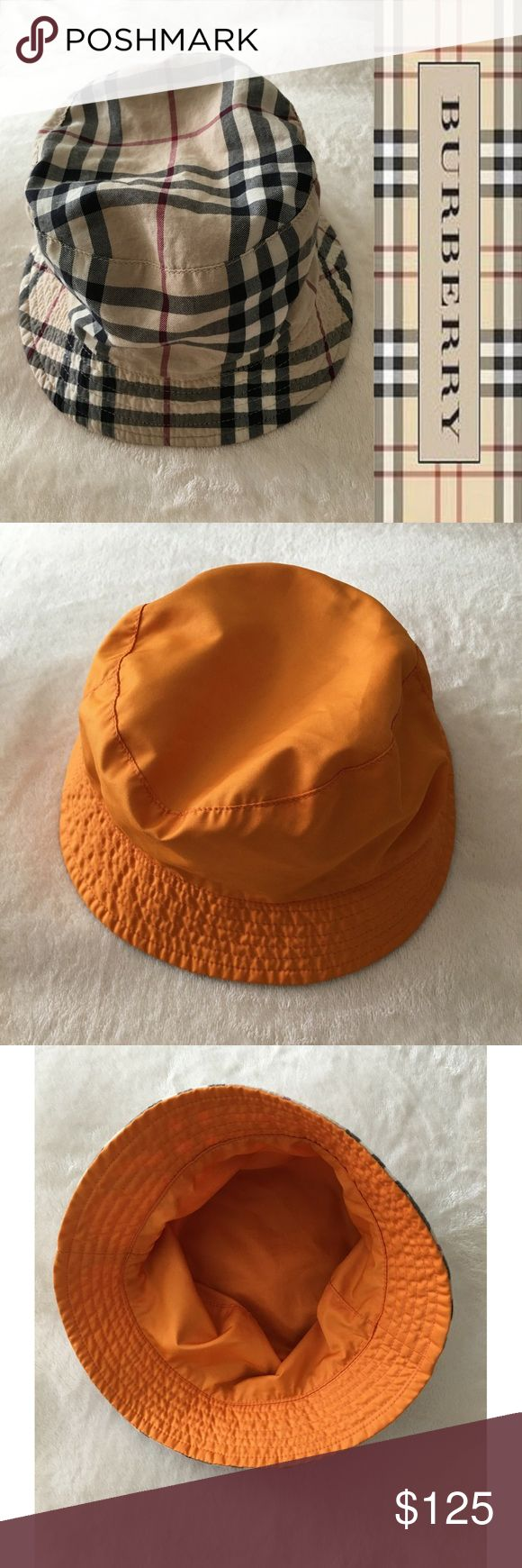 "Authentic Burberry Reversible Bucket Hat Authentic Burberry reversible original checker one side and orange other side.  Bought it at Bloomingdales only worn 2 times.  Circumference 24"" fits most. Burberry Accessories Hats"