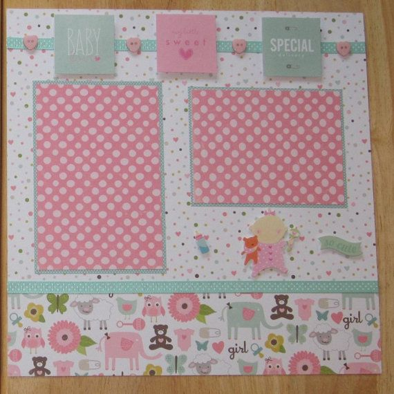 Welcome to the world baby girl! Preserve your favorite photos of your baby girl with this premade two page layout using a soft pastel theme of salmon pink and mint green. The background of the left page has a multicolored dot pattern where some of the dots are pink hearts. The coordinating paper is a patterned paper of baby girl themed animals. The papers are divided with a mint green dotted ribbon. The larger horizontal photo mat will hold a 4 x 6 sized photo while the smaller two mats…