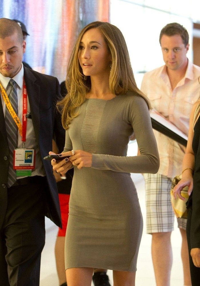 Maggie Q in sophisticated long sleeved bodycon gray