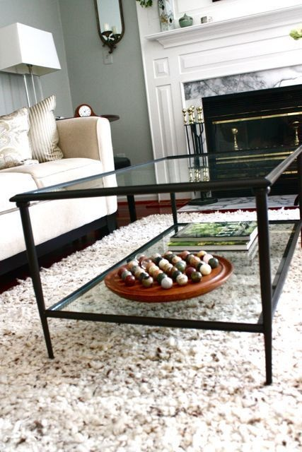 Love this two-tiered glass coffee table. Modern traditional