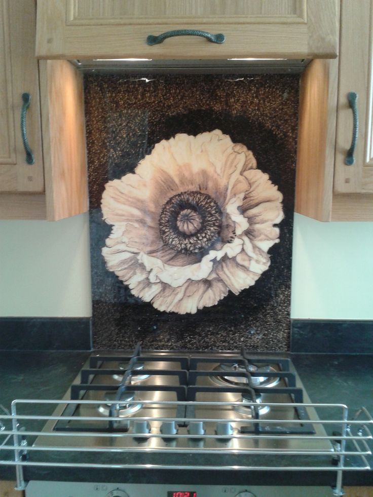 A Sepia Poppy splashback with ideal colours to blend beautifully with the colours of the kitchen. milestone.uk.net