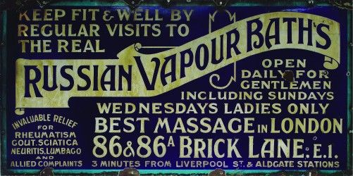 This sign was used to advertise the Russian Vapour Baths in Brick Lane. The baths were more popularly known as 'Schewzik's', after their owner Benjamin Schewzik. The steam baths were used by the large immigrant Jewish community living in London's East End from the late 19th century. They were an important part of social and religious life and were mostly used by men following work on a Friday evening, before going to the synagogue for prayers.