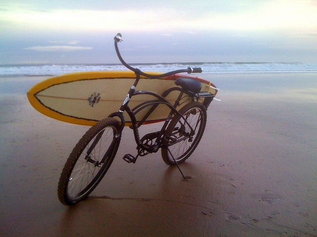 "Beach cruiser with Carver surf rack and 8'2"" Mini-Mal surfboard."