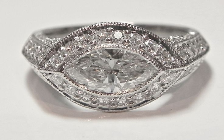 A marquis solitaire and diamond wedding bands transformed into a beautiful right hand ring.