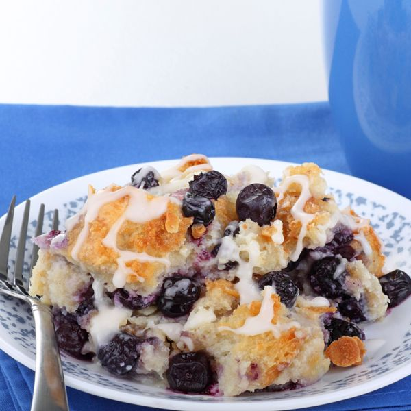 A warm and inviting blueberry bread pudding recipe, served with a sweet icing drizzle.