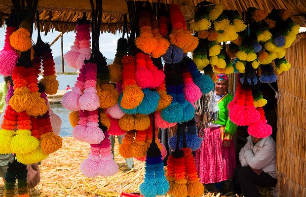 pom poms made and worn by quechua women on the floating islands of lake titicaca in peru