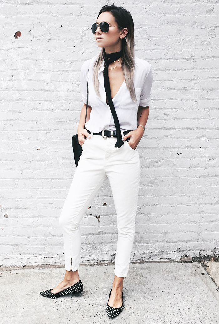 Danielle Bernstein of We Wore What wears a white button-down shirt, belted white jeans, studded ballet flats, and a skinny scarf