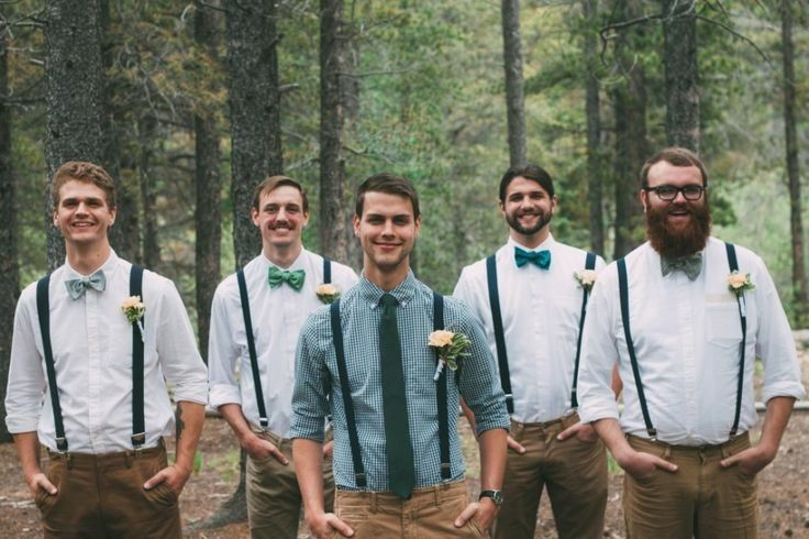 Khaki pants, groom in coral shirt with navy suspenders and bow tie, groomsmen in white shirts, navy suspenders/tie