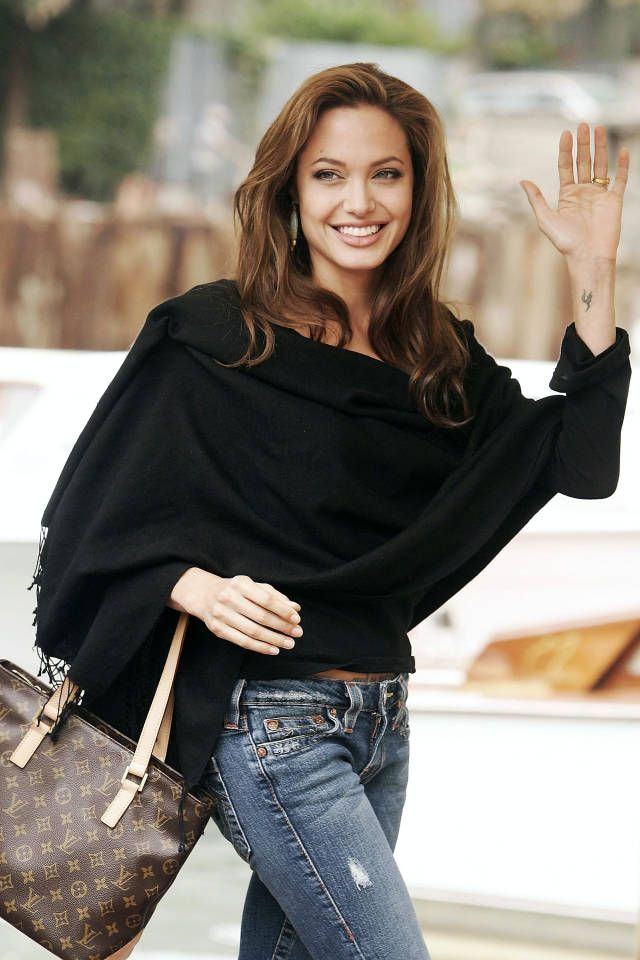 Blue jeans, chocolate bag and black sweater