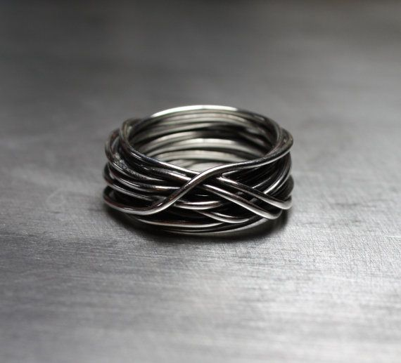Unique mens wedding band or super cool mens ring. This masculine wire wrapped ring is made from sterling silver wire thats been wrapped and