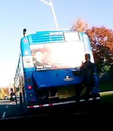 Dash cam records man riding on back of York Region bus