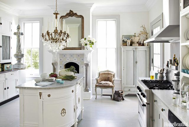 Kitchen beautiful! An elegant European inspired white kitchen with collected antiques, crystal chandeliers, fireplace, and delft tiles. The design is by homeowner Annie Brahler of Euro Trash. House Tour: Annie Brahler {European Country Decor} - Hello Lovely