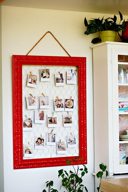 Frame and chicken wire to display photos