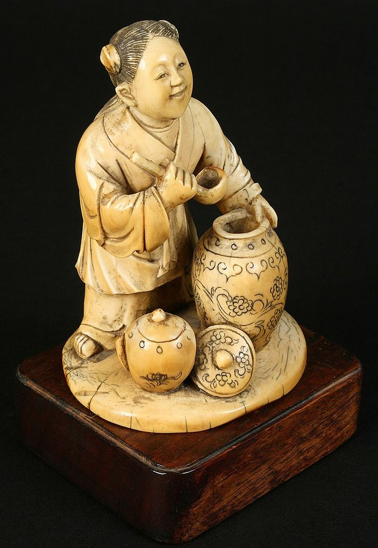 "A nicely detailed (listed as Japanese but most likely Chinese)Okimono depicting a female figure ladeling contents of ornate vessel, resting on a wood base circa 1910.  Dimensions: Ht: 5"" Width: 3"" Depth: 3"""