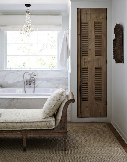 Old rustic shutter door used in the bath. Great to hide all the towels and toiletries...and add some rustic charm...