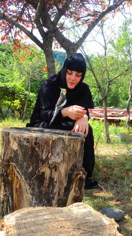 Young Byzantine nun with her new friend