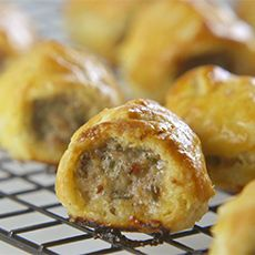 Sausage Rolls - Mum use to make enough to fill two big Quality Street tins. She lined it with grease-proof paper and then a layer of kitchen towel. They only lasted a day :0)