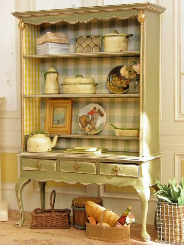 Sage green shabby chippy cupboard with background covered in buffalo check...so cute