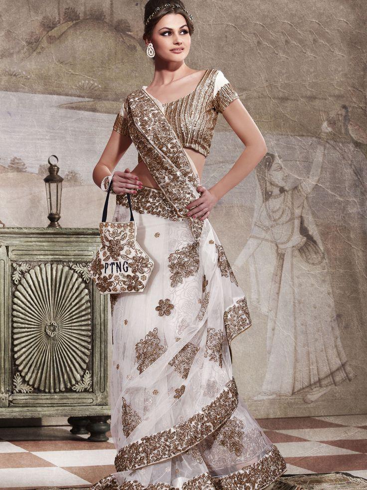 Elegant Off #White Net #Saree with #Blouse @ $94.73 | Shop Here: http://www.utsavfashion.com/store/sarees-large.aspx?icode=slskk10898 #netsaree #snapdeal #India
