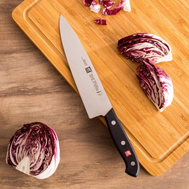 The all-rounder for professional and hobby chefs, also called a cook's knife, is a versatile kitchen knife available in various lengths of 6, 8, 10, and 12 inches. The heft, weight and balance of this knife allow it to be used for both heavy duty work with thicker cuts of vegetables, fruits and meats or mincing and chopping herbs. The curved blade enables a rocking cut and wide surface enables knuckle clearance and gathering of cut materials.