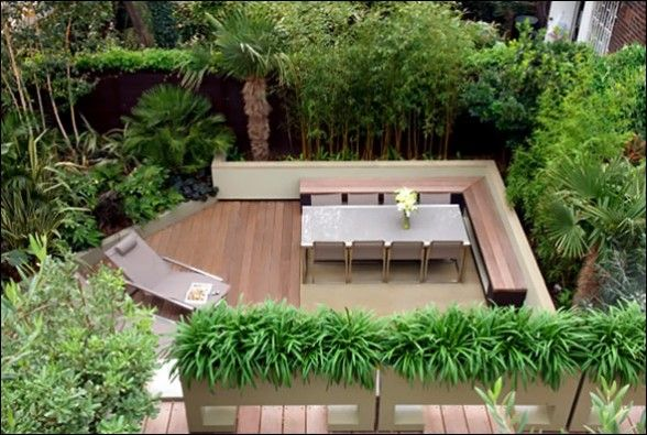 Love the decking, wrap around seating and the bamboo screening. Lovely idea for an outdoor eating area.