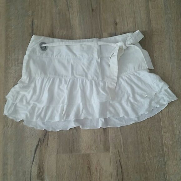 """Triple 5 Soul white micro skirt with ruffles So cute and stylish. White skirt with two layer of ruffles.  Upper part white denim like cotton, ruffles are tee- shirt cotton. 12"""" length. Perfect condition. Comes from a super clean and smoke free home. Triple 5 Soul Skirts Mini"""