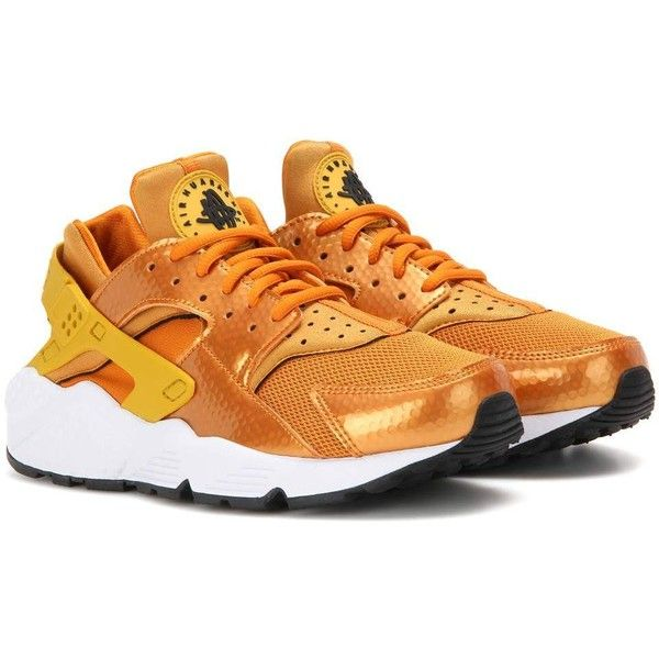 Nike Air Huarache Run Sneakers ($135) ❤ liked on Polyvore featuring shoes, sneakers, nike, orange, nike trainers, nike shoes, orange sneakers and nike footwear