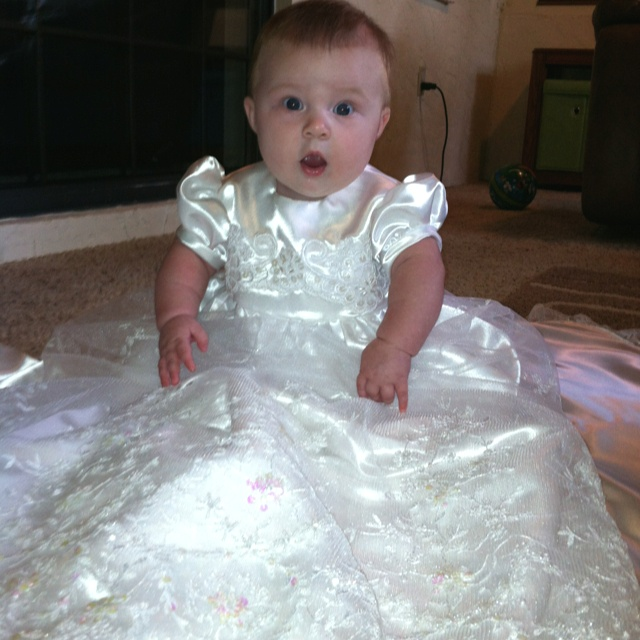 Beautiful Baby trying on her Baptismal Gown