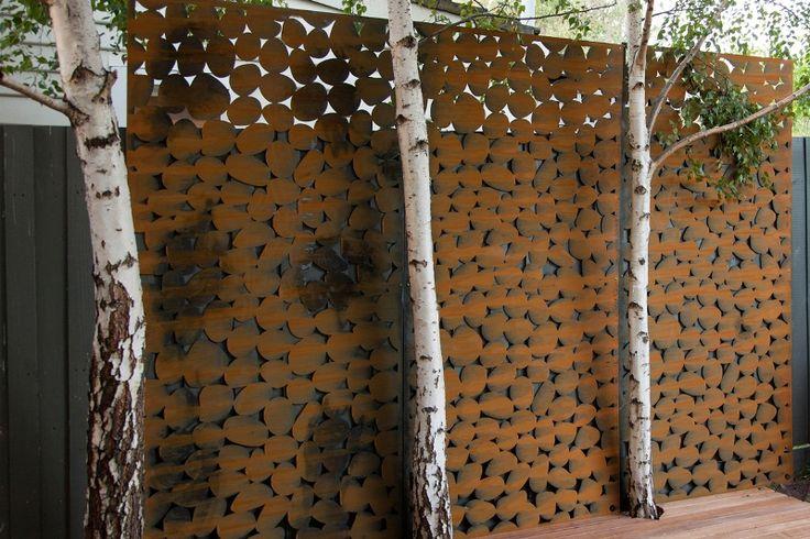 set of 3 garden screens screening off neighbouring areas. 'Pebbles' design