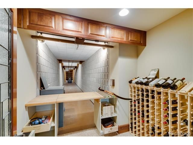 Your very own indoor home archery range, with a wine rack! Hey!