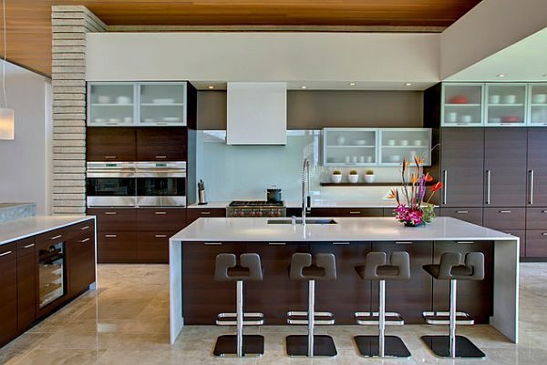 Super details for a highly modern kitchen with some fancy bar stools – by John Senhauser Architects