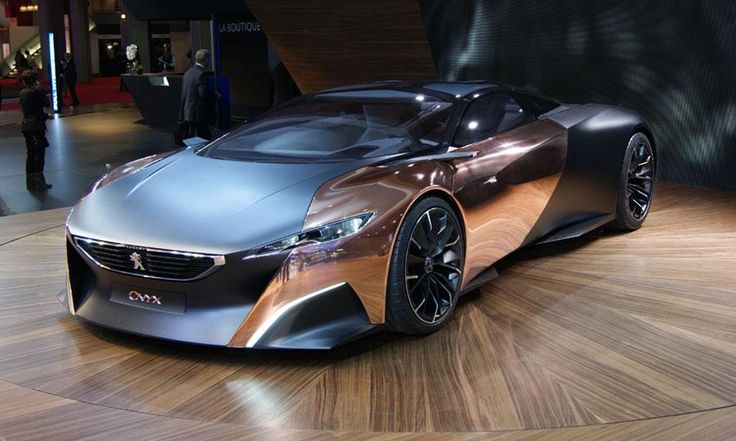 The Peugeot Onyx concept at the Paris motor show. This thing is such a ridiculously French monstrosity. I love it.