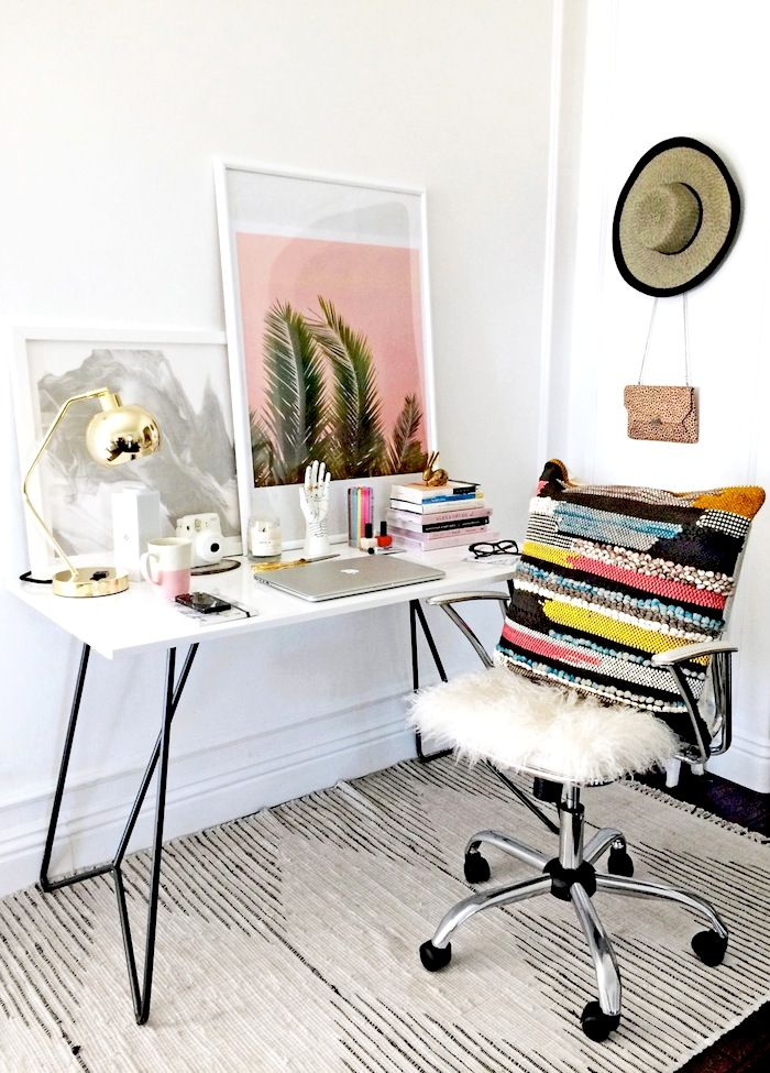 7 key elements for a stylish & whimsical work space // white desk, colorful textured pillow, white desk chair, palm print, striped rug & gold lamp #office #interiordesign #homedecor