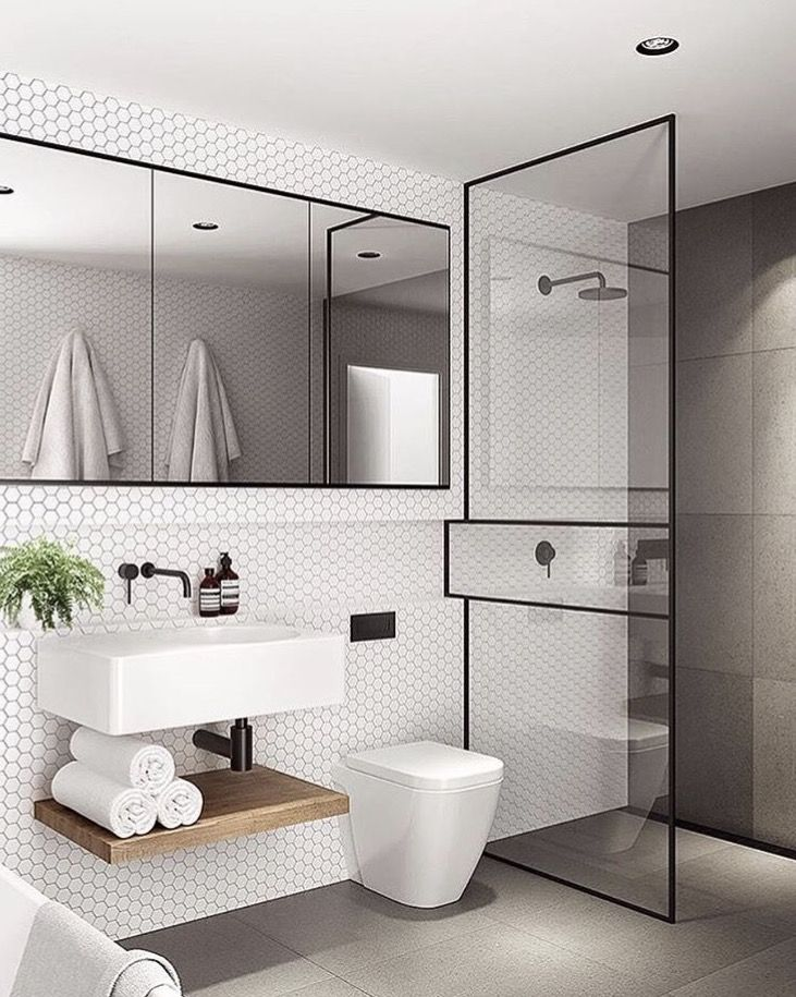Black framed shower screen; mirrored medicine cabinets; contrast tiling colours