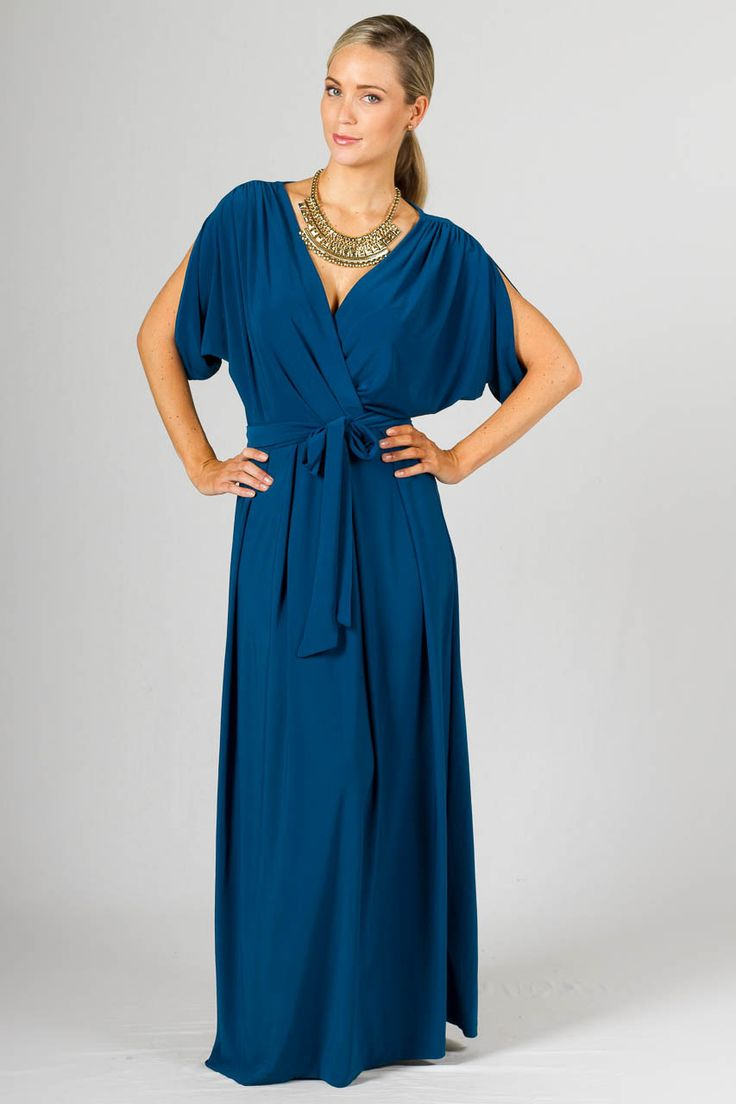 """Batwing Long Maxi Dress - Teal - Paper Scissors Frock. Long Batwing style maxi with deep cross-over look front, box pleating, gathering on the sleeves & batwing style sleeve. Comes with a removable belt in the same fabric as the frock.  Made from high quality ITY polyester.  Pictured Models is 5'8"""""""