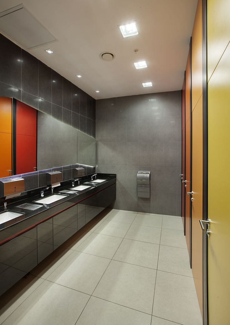 TOILETS Use of colour to laminate finishes a cost effective way to brighten the space