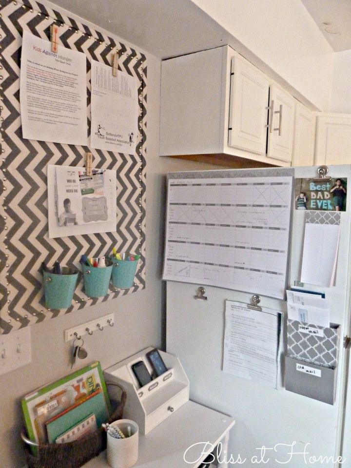 good ideas: fabric covered bulletin board, added magnets to hold buckets & clips to hold paper.