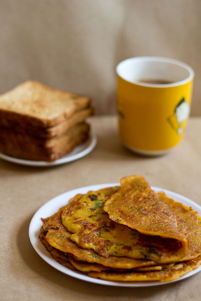 tomato omelette: vegetarian omelette made with gram flour with indian herbs & spices. no eggs and cooked in oil.