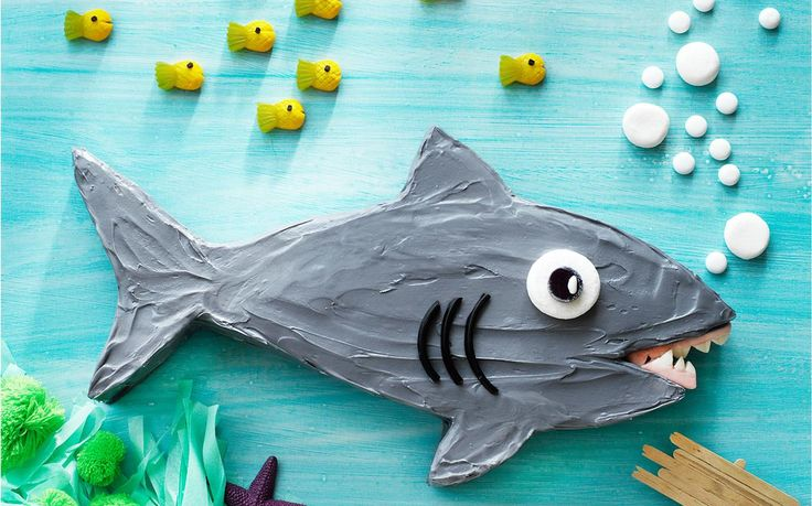 Sammy the shark lives under the sea with big sharp lolly teeth, blowing, marshmallow bubbles. Perfect cake for an underwater themed birthday party.